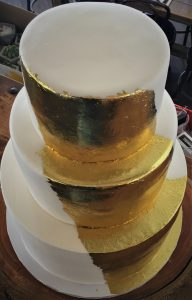 3 tier wedding cake finished with gold leaf