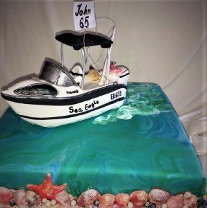 boat on ocean cake