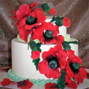 2 tier wedding cake with red sugar flowers