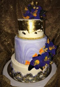 3 tier wedding cake with sugar flowers and gold leaf