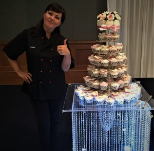 cupcake tower on display stand at reception