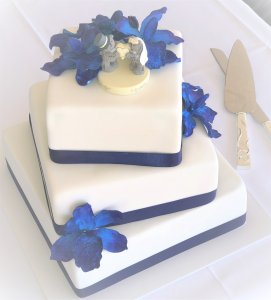 3 tier blue and white wedding cake