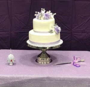 rimma's wedding cakes 2 tier fondant wedding cake on stand at reception