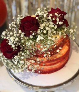 rimma's wedding cakes 2 tier red buttercream wedding cake with beautiful fresh red roses