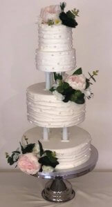 rimma's wedding cakes 3 tier wedding cakes on pillars with silk flowers