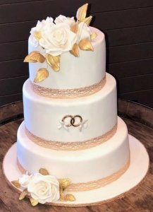 3 tier wedding cake with wedding rings