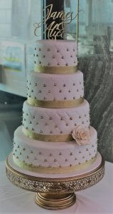 four tier pearl studded wedding cake