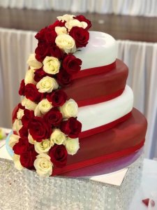 4 tier wedding cake with fresh flowers in heart shape