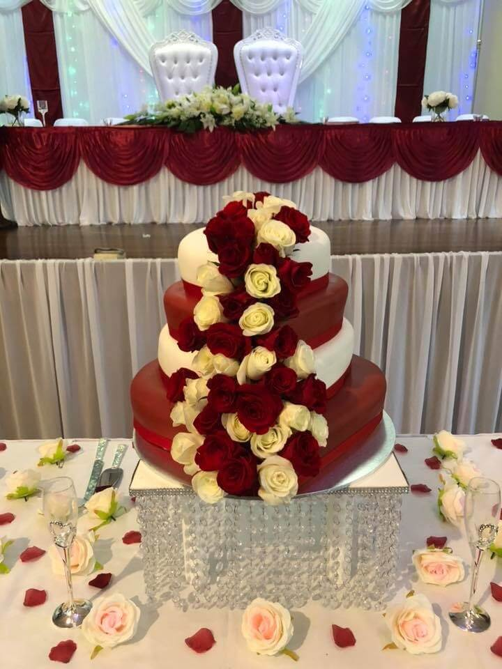 four tier heart shaped wedding cake with fresh roses