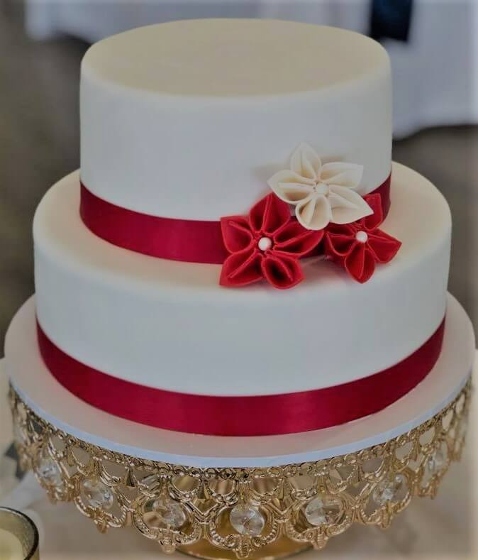 two tier red and white wedding cake