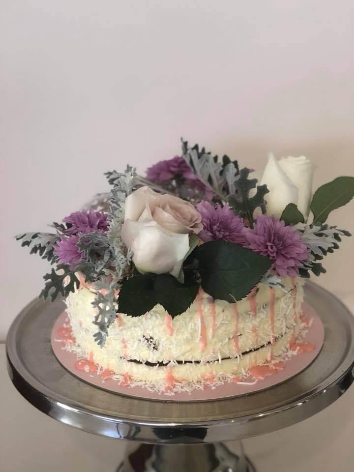 honey birthday cake with fresh flowers