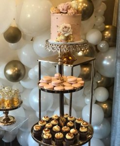 pink and gold wedding cake at reception
