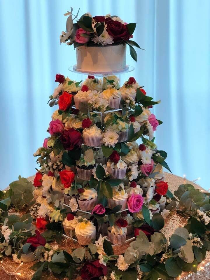 six tier stunning cupcake tower with fresh flowers