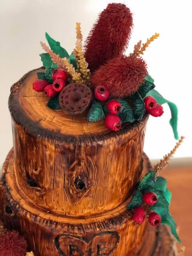 timber themed wedding cake with hand made banksia native flowers