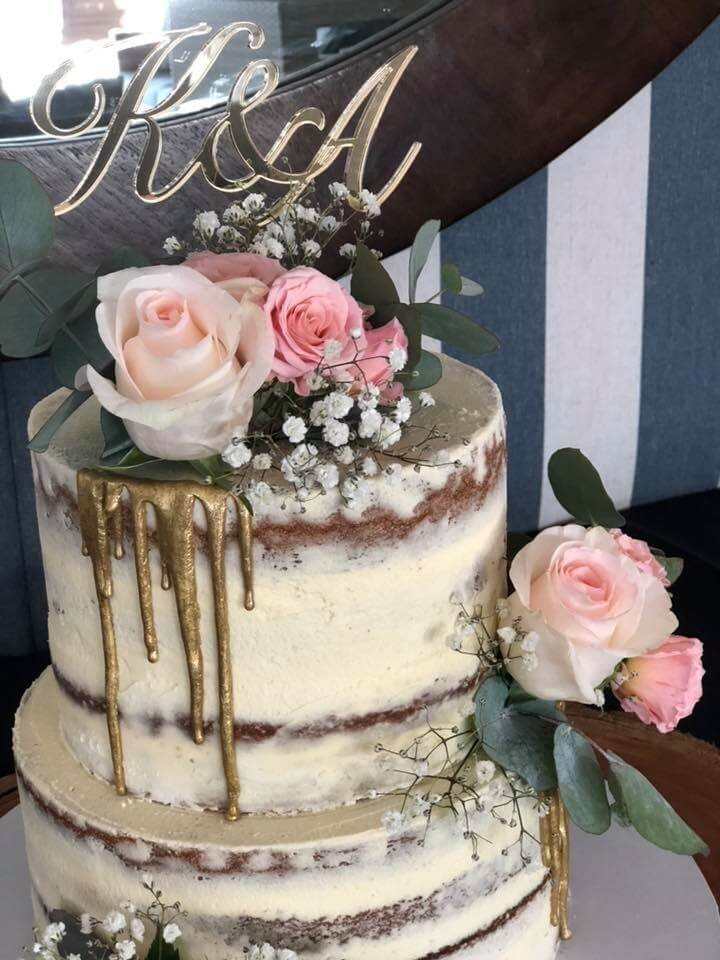 two tier wedding cake with extra tall tiers in a rustic style