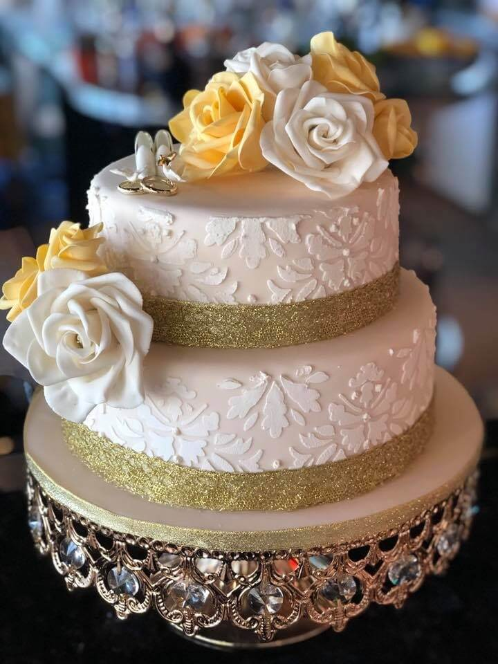 two tier wedding cake with hand made sugar flowers