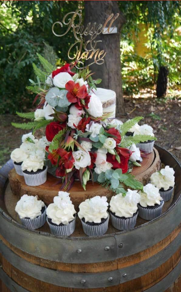 2 tier gluten free wedding cake with cupcakes