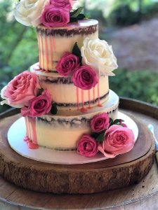 3 tier pink buttercream wedding cake