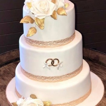 3 tier white wedding cake gold leaf and sugar flowers