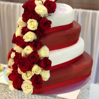 4 tier heart shaped red and white wedding cake