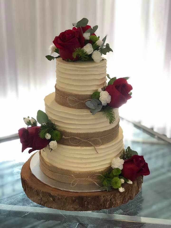 3 tier butter cream wedding cake with fresh roses