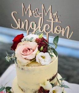3 tier buttercream wedding cake with custom topper