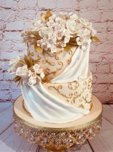 2 tier wedding cake on display stand