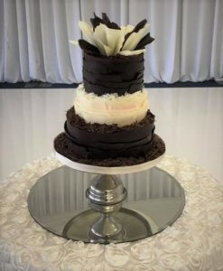 3 tier chocolate wedding cake with large chocolate shardes