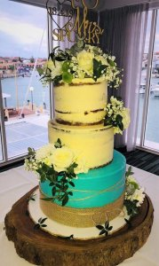 3 tier buttercream wedding cake with blue base