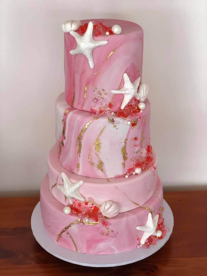 pink beached themed wedding cake