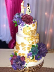 3 tier wedding cake with large amounts of stencil work