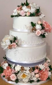 3 tier wedding cake with large amount of gum paste flowers