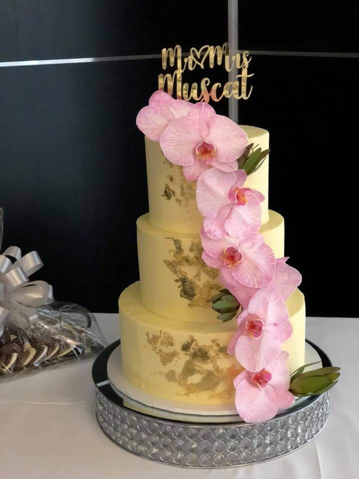 3 tier wedding cake with gold leaf