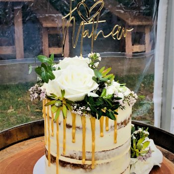 high buttercream wedding cake with fresh flowers by rimmas wedding cakes perth