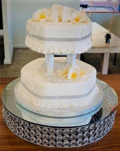 2 tier pedestal octagonal wedding cake with sugar flowers by rimma's wedding cakes perth