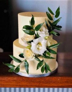 2 tier white wedding cake with fresh flowers by rimma's wedding cakes perth