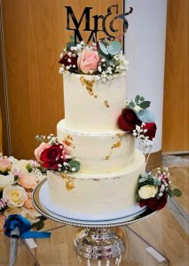 3 tier buttercream wedding cake with frsh flowers by rimma's wedding cakes perth