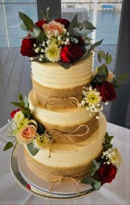 3 tier buttercream wedding cake with red and pink roses by rimma's wedding cakes perth