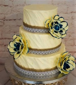 3 tier buttercream wedding cake with sugar paste flowers by rimma's wedding cakes perth