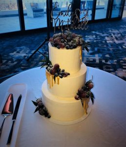 3 tier buttercream wedding cake with white chocolate dripping and fresh fruits by rimma's wedding cakes perth