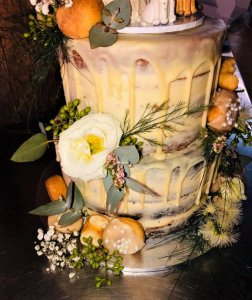 3 tier buttercream wedding cake with donuts and fresh flowers by rimma's wedding cakes perth