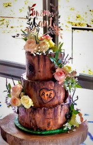 3 tier log themed wedding cake with fresh flowers and custom cake topper by rimma's wedding cakes perth