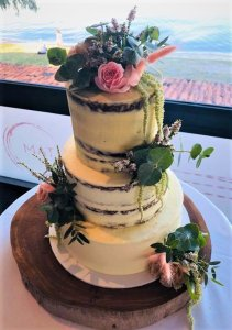 3 tier semi naked wedding cake with fresh flowers by rimma's wedding cakes perth
