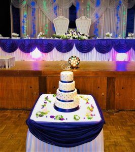 4 tier white wedding cake with purple ribbon and edible diamonds by rimma's wedding cakes perth