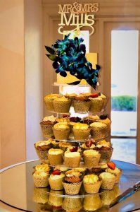 cupcake tower with fresh blue orchids by rimma's wedding cakes perth