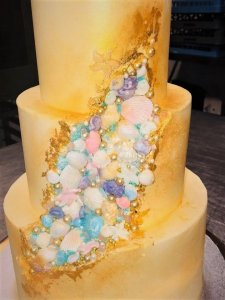 3 tier wedding cake with fondant shells 🐚 and pearls, golden leaf and golden dust for decor
